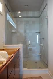 glass shower doors steel frame on white rectangle ceramic bathtub