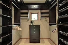 stylish dark black walk in closet designs in modern with darkwood