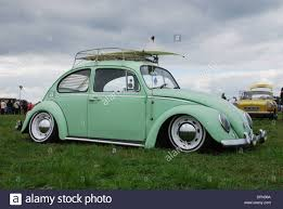 green volkswagen beetle 2016 classic mint green vw beetle low rider stock photo royalty free