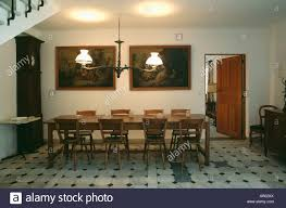 Lighting Over Dining Room Table by Victorian Style Lighting Above Rectangular Wooden Table And Chairs