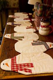 make christmas table runner 7 quilted holiday table runners diy christmas snowman and holiday