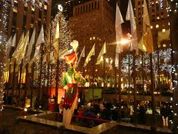 christmas tree and musical player in rockefeller center new york