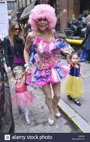 bethenny frankel dressed up for halloween in a pink wig and dress