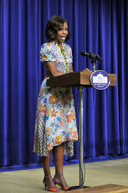 michelle obama in tan suit at d c high fashion and
