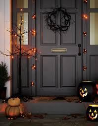 orange led lights add spooky illumination to bare branched black