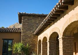 Mediterranean Roof Tile Brick And Stone Exterior Exterior Mediterranean With Tropical