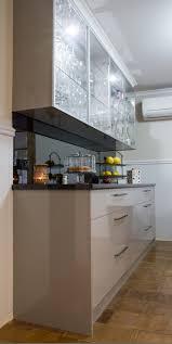 smoked mirror backsplash buffet bar modern style smoked mirror splashback glass overhead