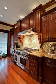 granite countertops cherry wood kitchen cabinets lighting flooring