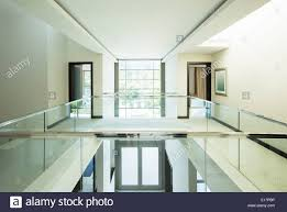 modern balcony and open foyer in luxury home stock photo royalty