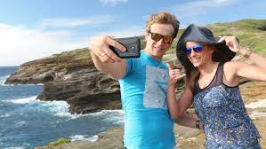 Hawaii best travel camera images Tourist woman taking selfie photo with smartphone best friends jpg