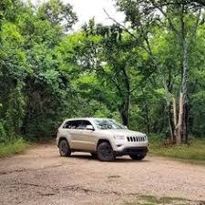 gold jeep grand cherokee 2014 the 2014 jeep grand cherokee takes on the jeep test track at the