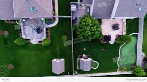 aerial view of backyard putting green from in air stock video