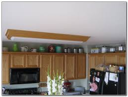 Decorating Above Kitchen Cabinets Greenery Above Kitchen Cabinets