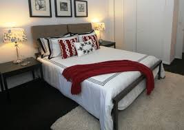 black and white with red accents bedroom staged to sell home