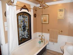 tara april glatzel the sister team info for the upstairs hallway bathroom with tile floor original clawfoot tub and a separate shower