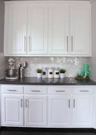Herringbone Kitchen Backsplash I Love The Herringbone And The White Cabinets And The Pops Of Teal