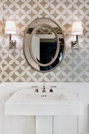 round antique mirror with white trim powder room traditional and
