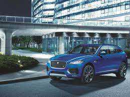 light blue land rover jaguar land rover will offer electric options on all models from