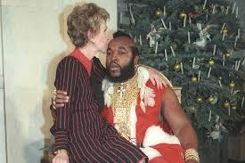 Mr T Meme - nancy reagan kissing mr t as santa claus for white house christmas