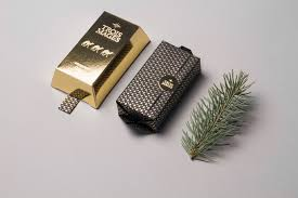 trois mages festive gold bar soap on packaging of the world
