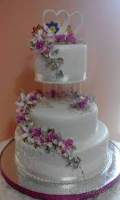 3 tier engagement cake with roses and multi color flowers sri