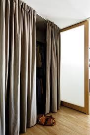 the walk in wardrobe has a curtain u0027door u0027 to soften the look in
