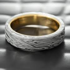wedding band photos flat damascus steel men s wedding band with 14k gold