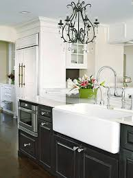 black cabinets with white farm sink contemporary kitchen