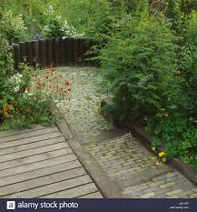 Sunken Patio Decking Borders And Paving To Sunken Patio With Wooden Fence Stock