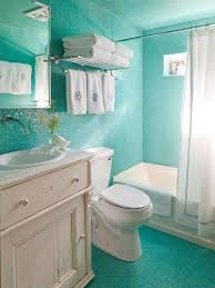 chic turquoise mosaic tiles ocean inspired bathroom with white