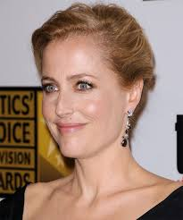 side view of pulled back hair in a bun gillian anderson updo long straight casual updo hairstyle medium