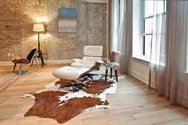 accessories brown cowhide rug with eames chair replica and floor