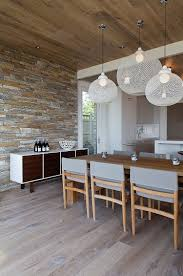 warm wood flooring and cool stone wall combination in naramata