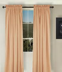 solid peach or salmon colored long curtains