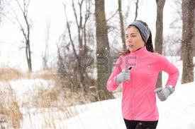 asian headband woman running in cold weather wearing winter accessories pink