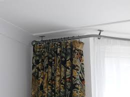 Ceiling Curtain Track by Ungathered Curtain Heading Dressed Under Pole Curtain