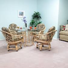 Dining Room Chairs With Casters by Light Brown Rattan Chairs With Bars On The Back Combined With