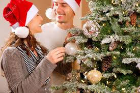 Their Home by Happy Couple Decorating Christmas Tree In Their Home Stock Photo