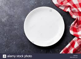 plate table top empty plate and kitchen towel over stone table top view with copy