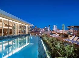 Top  Dallas Apartment Pools To See And Be Seen This Summer - Design district apartments dallas