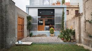 small house in spanish sliding panels open up facade of barcelona house by h arquitectes