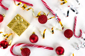 christmas decoration gold gift box and candy cane on light