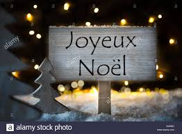 white tree joyeux noel means merry stock photo royalty