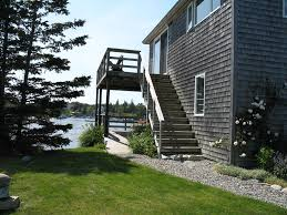 downstairs level of two story home on the water in bass harbor