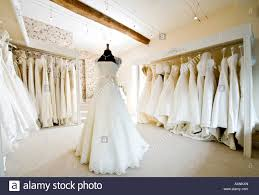 wedding boutique interior of wedding dress gown in bridal boutique shop stock photo