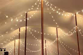 how to string cafe lights tent and sailcloth tent lighting ideas goodwin events