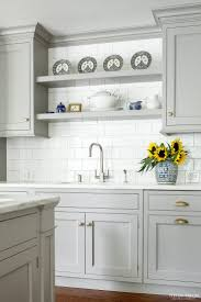 grey kitchen cabinets home decoration ideas grey or white kitchen cabinets heidi piron design and cabinetry traditional shelving over sink when no window