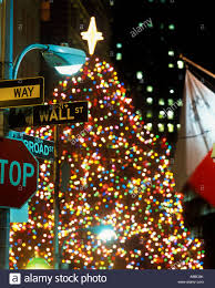 christmas tree lights wall street sign financial district