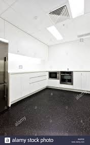 white kitchen cabinets black tile floor luxury kitchen included silver ovens attached to wall