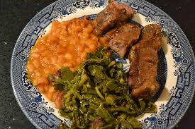 country style ribs and kale braised in apple juice waytoobig